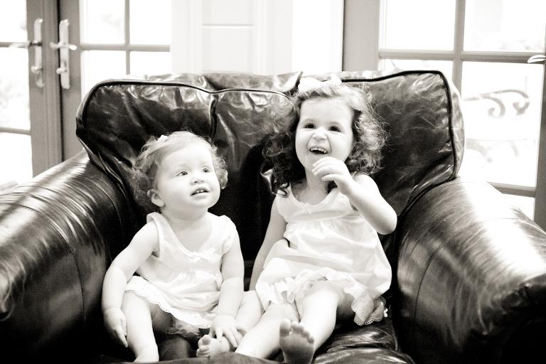 girls sitting in big chair