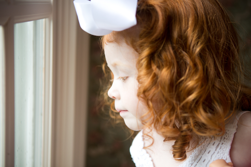 redhead girl near window