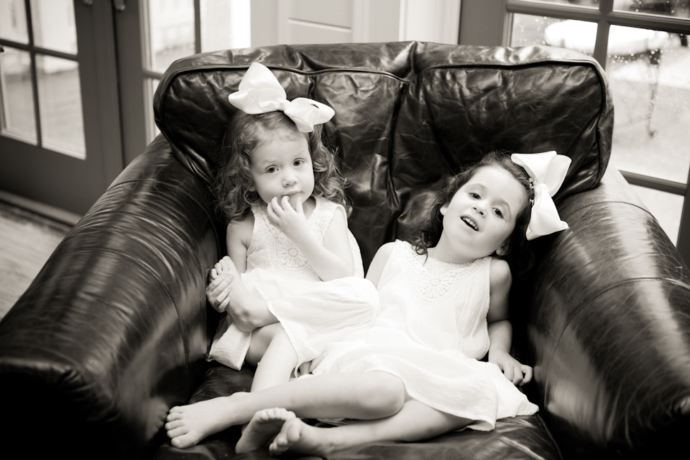 little girls sharing chair