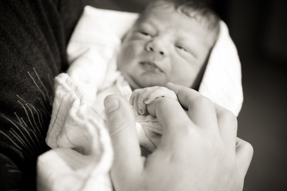 son holding dad's finger