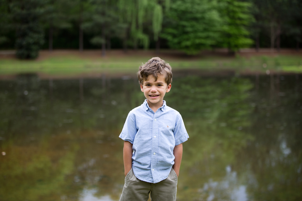boy portrait by pond