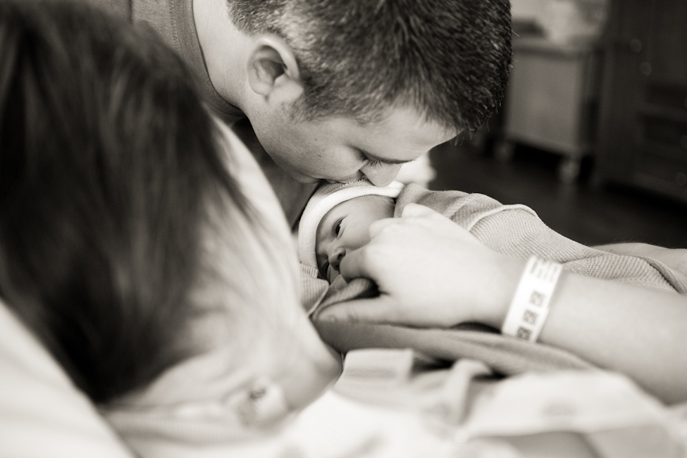 daddy kissing new baby