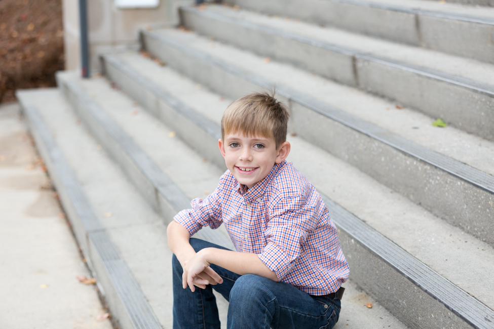young boy sitting on stairs