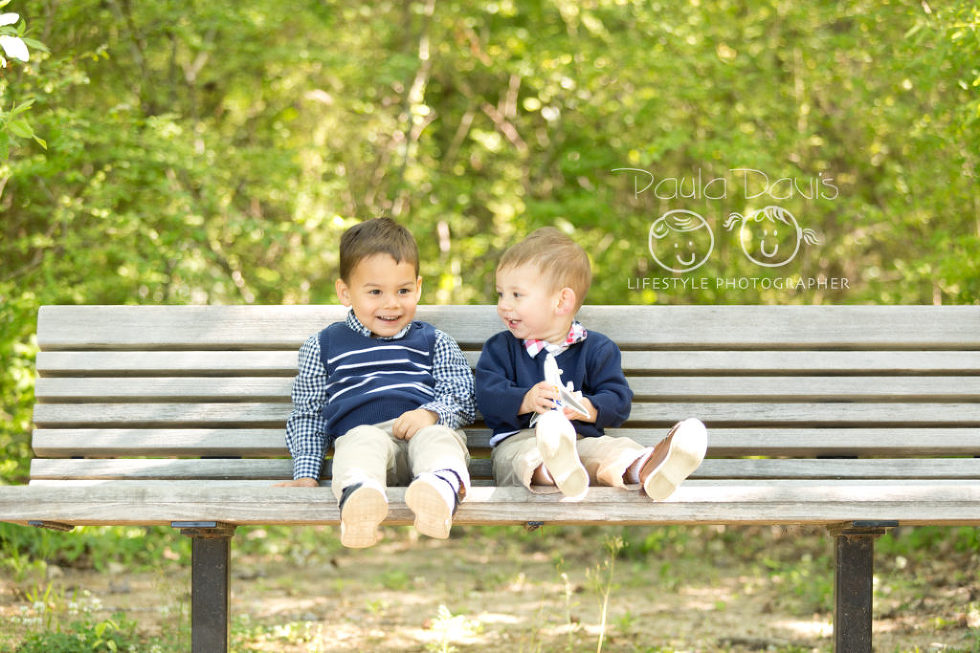 boys smiling together on a bench