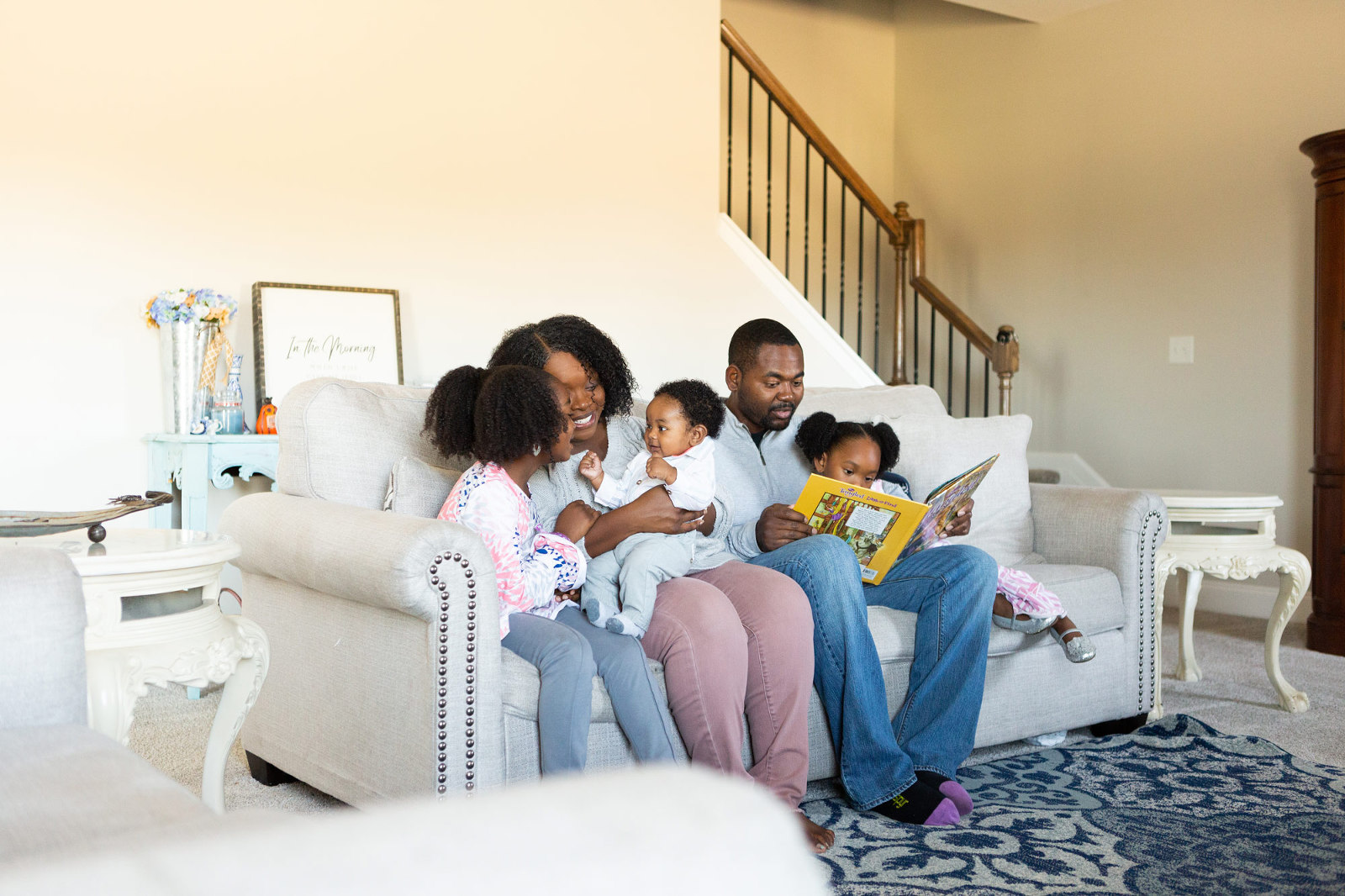 family sitting together on a couch during a lifestyle session
