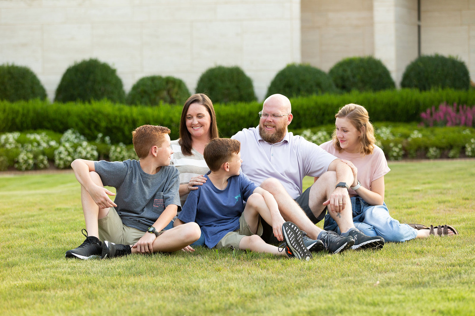 family laughs together on the grass near jules collins smith museum