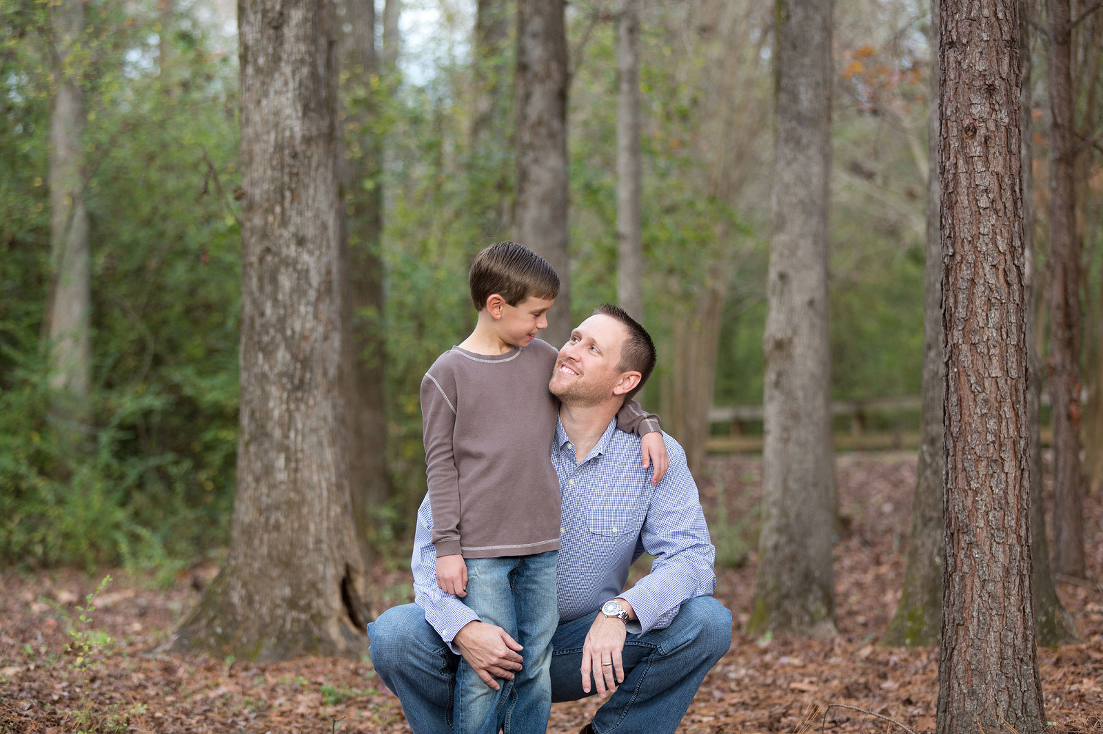 dad and son smile together at town creek park
