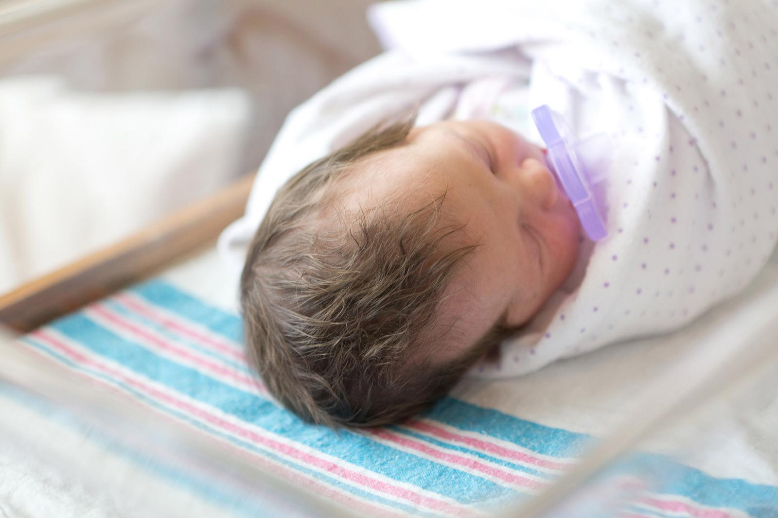 newborn baby with thick dark hair