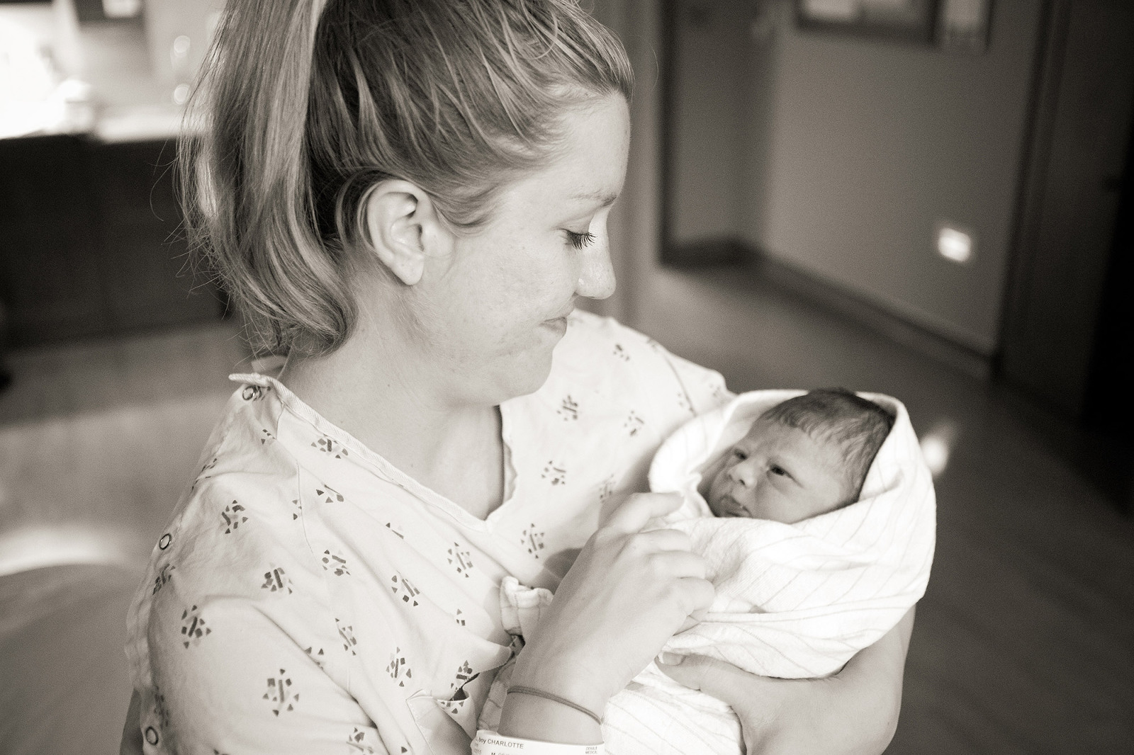 mom holds her new baby after giving birth at see baby
