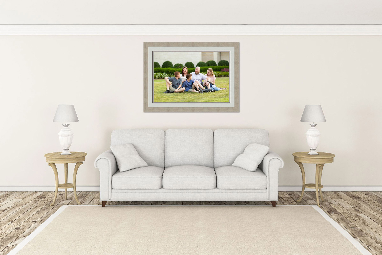 sample family portrait displayed above couch after session