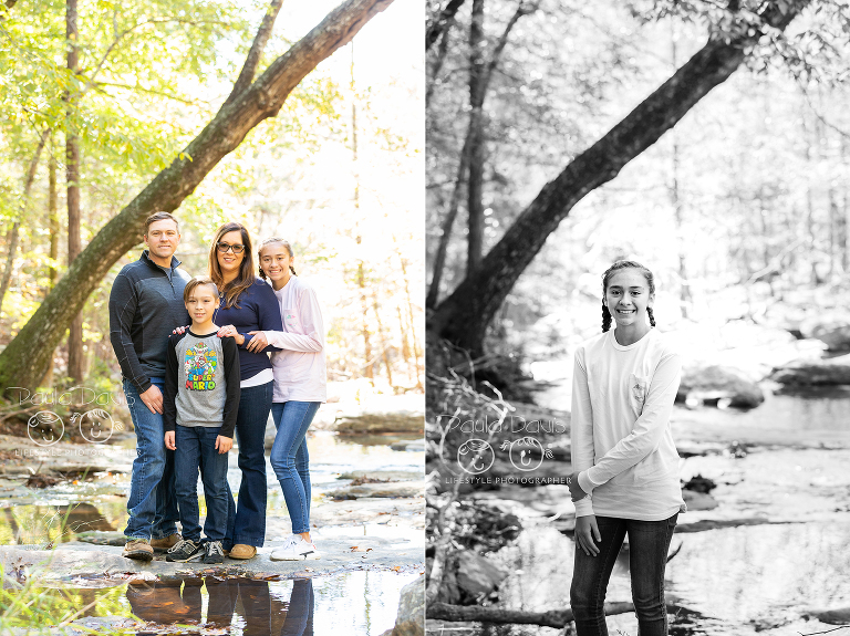 family standing on rocks in a creek
