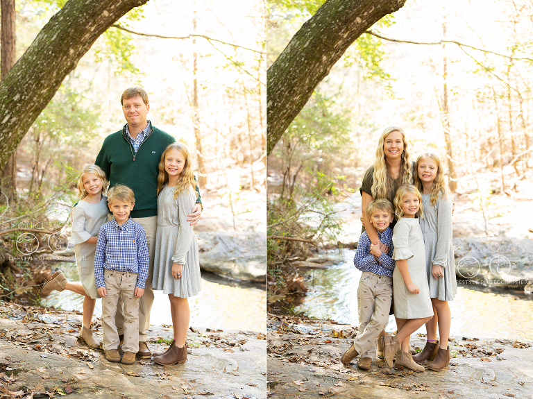 kids standing with their parents on a rock in a creek