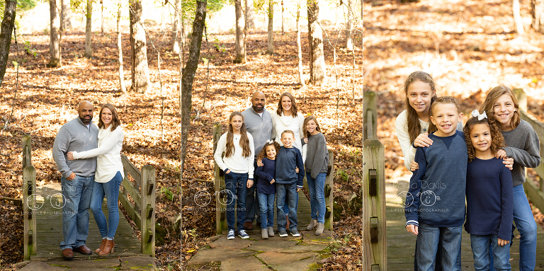 family standing together on a small bridge in the woods