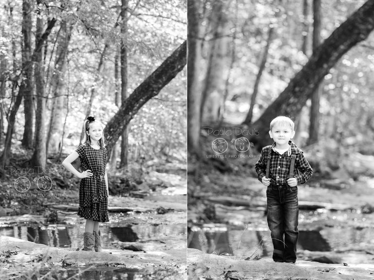 children in black and white standing in a creek bed