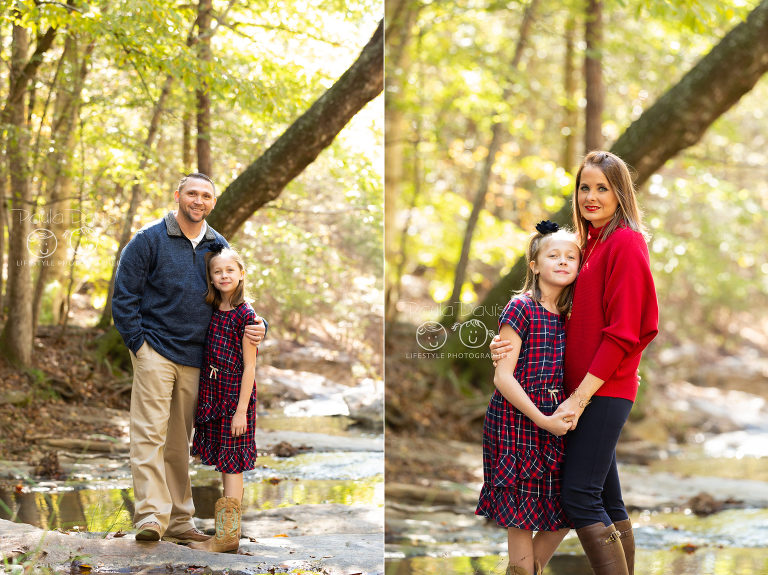 daughter standing with her parents in a georgia creek