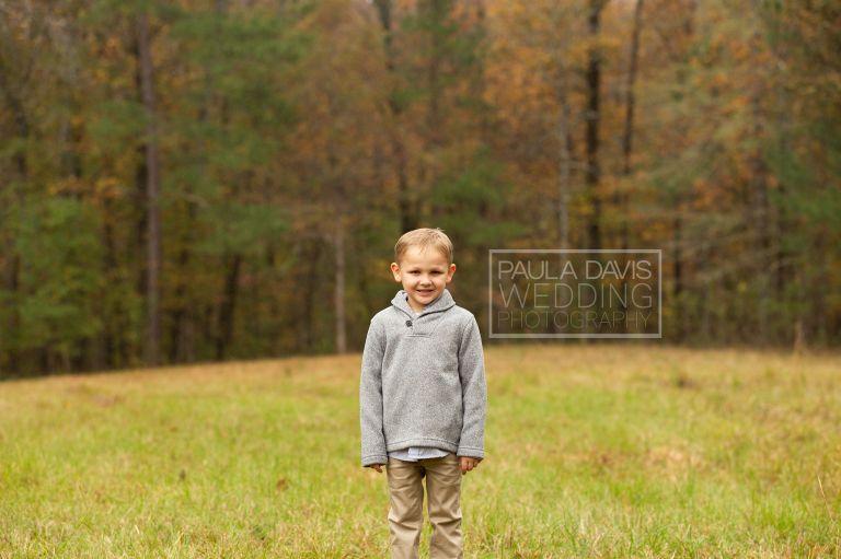 boy in a gray sweater in a field